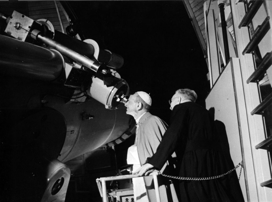 Pope St. Paul VI looking at the moon.